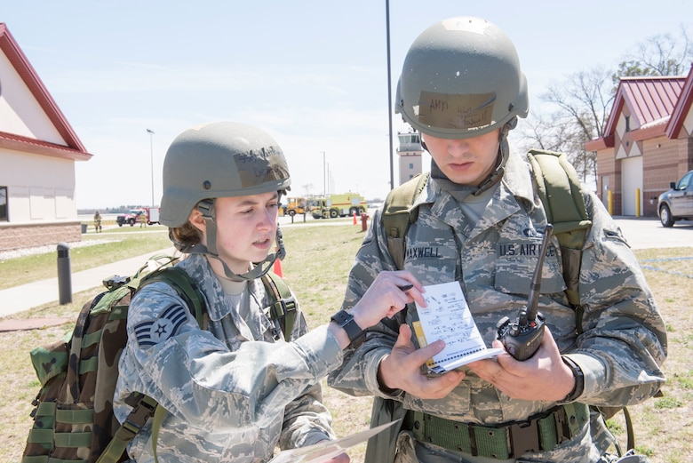 Staff Sgt. Kathryn Demory and Airman Ian Maxwell, both assigned to the 167th Airlift Wing's aviation resource management systems section, review post-attack procedures during a training exercise at Alpena Combat Readiness Training Center, Alpena, Mich., May 7, 2019. Approximately 300 167th AW Airmen participated in the training event. (U.S. Air National Guard photo by Senior Master Sgt. Emily Beightol-Deyerle)