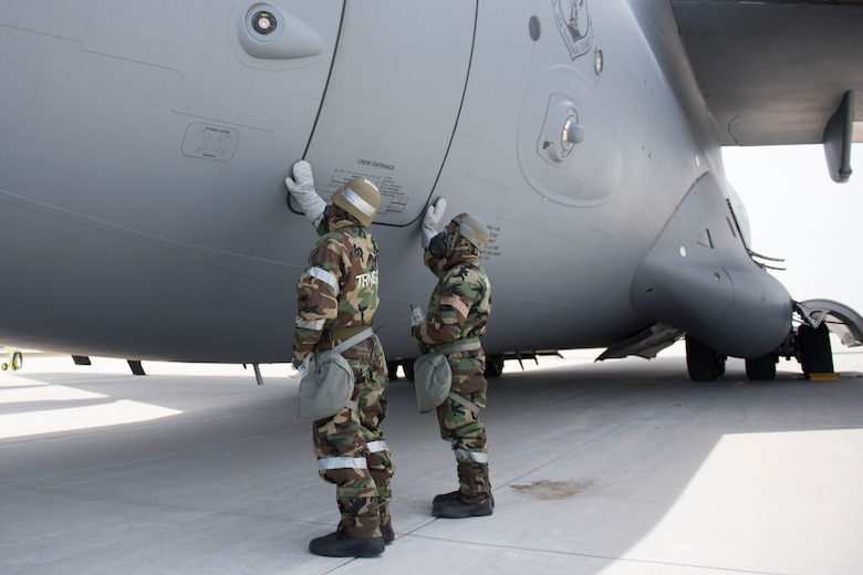 167th Airlift Wing aircraft maintainers simulate decontaminating a crew entrance door on a C-17 aircraft during a training exercise at Alpena Combat Readiness Training Center, Alpena, Mich., May 8, 2019. Approximately 300 167th AW Airmen participated in the training event. (U.S. Air National Guard photo by Tech. Sgt. Jodie Witmer)