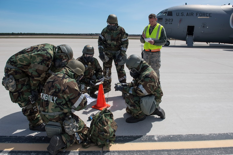 167th Airlift Wing aircraft maintainers access contamination on the flight line during a during a training exercise at Alpena Combat Readiness Training Center, Alpena, Mich., May 8, 2019. Approximately 300 167th AW Airmen participated in the training event. (U.S. Air National Guard photo by Senior Master Sgt. Emily Beightol-Deyerle)