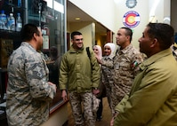 U.S. Air Force Senior Master Sgt. Jose Alfaro, 140th Wing Security Forces, Colorado Air National Guard, escorts members of the Royal Jordanian Air Force on a tour of the Chief Warrant Officer 5 Dave Carter Army Aviation Support Facility at Buckley Air Force Base, Aurora, Colorado, Feb. 5, 2019. The meeting between Jordanians and senior enlisted leaders aimed to foster strong relationships between forces as well as enhance Jordanian enlisted policy and practices. Jordan and Colorado have been partners since 2004.