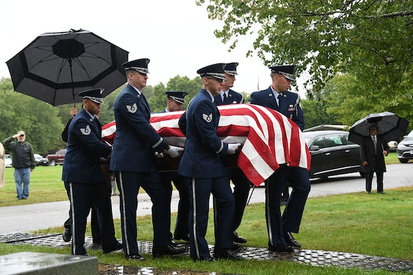 Members of the Hanscom Air Force Base, Mass. Patriot Honor Guard carry the remains of U.S. Air Force Col. Fredric M. Mellor as he is laid to rest at Rhode Island Veterans Memorial Cemetery Sept. 28.