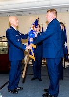 Brig. Gen. Terry L Bullard accepts the Air Force Office of Special Investigations flag from Lt. Gen. Sami D. Said, The Inspector General of the Air Force, during AFOSI's Change of Command Ceremony, May 16, 2019. General Bullard is the 19th Commander in the 70-year history of AFOSI. (U.S. Air Force photo by Mr. Michael Hastings)