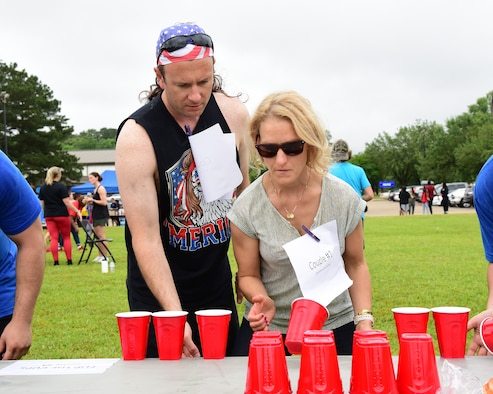Military spouses participate in various challenges during the Military Spouse Appreciation Day barbeque May 10, 2019, on Columbus Air Force Base, Miss. Similar to the challenges in the international game show, Minute to Win It, spouse groups raced against each other in a competition to see who could complete the challenges in the shortest amount of time (U.S. Air Force photo by Melissa Doublin)
