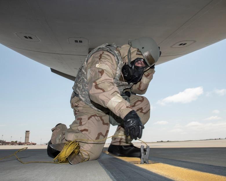An Airman grounds a C-17