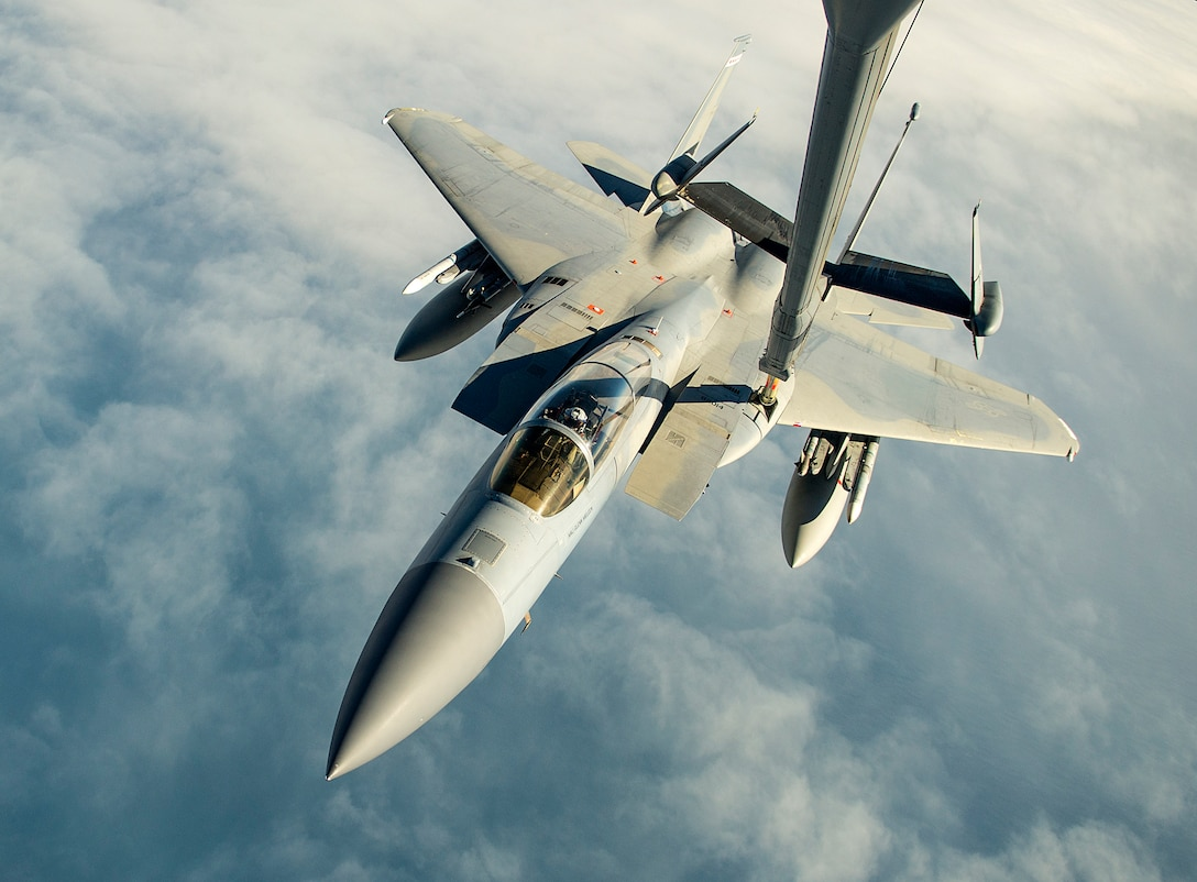 Airmen use a KC-10 Extender to refuel an F-15C