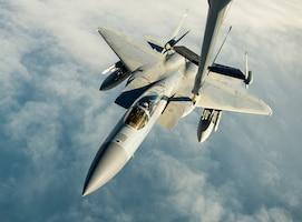 Airmen use a KC-10 Extender to refuel an F-15C