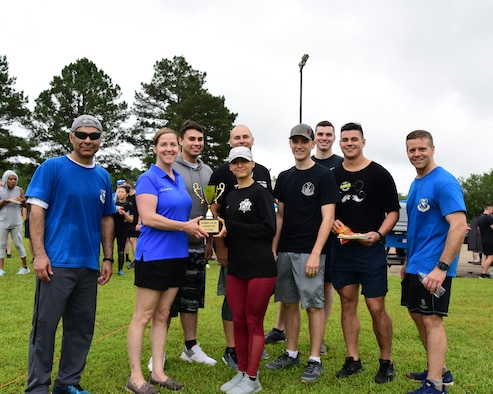 Leadership from the 14th Flying Training Wing stand with the first place winners of the A-BLAZIN' Race May 10, 2019, on Columbus Air Force Base, Miss. Nearly 230 Team BLAZE members signed up to participate in the A-BLAZIN' Race. (U.S. Air Force photo by Melissa Doublin)