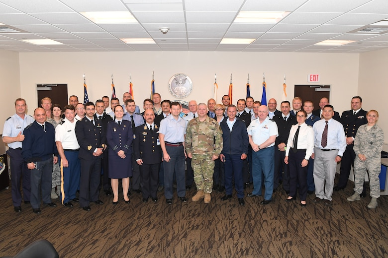 North Atlantic Treaty Organization (NATO) officials pose for a photo with service members from the Joint Force Space Component Command following a Combined Space Operations Center (CSpOC) mission brief at Vandenberg AFB, Calif., May 16, 2019.