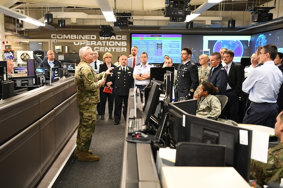 Col. Scott Brodeur, Director, Combined Space Operations Center (CSpOC), discusses space operations and capabilities with North Atlantic Treaty Organization (NATO) officials during a tour of the CSpOC at Vandenberg AFB, Calif., May 16, 2019.