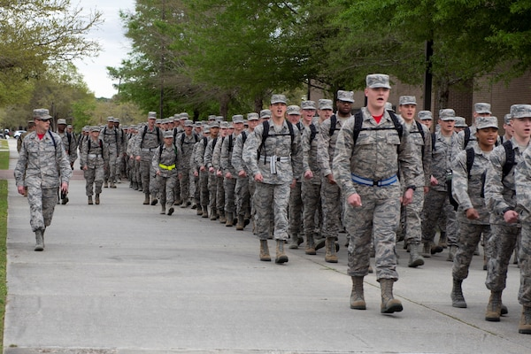 Tech. Sgt. Joshua Free, 336th Training Squadron military training leader, marches 336th TRS students to their dorms at Keesler Air Force Base, Mississippi, March 15, 2019. An AFIMSC initiative changing the method of payment for technical school student travel is projected to save the Air Force $5 million annually.