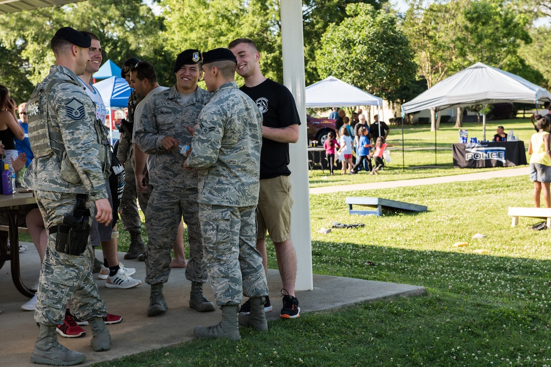 A group of 42nd Security Forces Squadron Airmen talk amongst one another at the Maxwell Police Week Jamboree at Freedom Park.