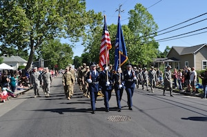 Military members march in the annual Dixon May Fair Parade, May 11, 2019.