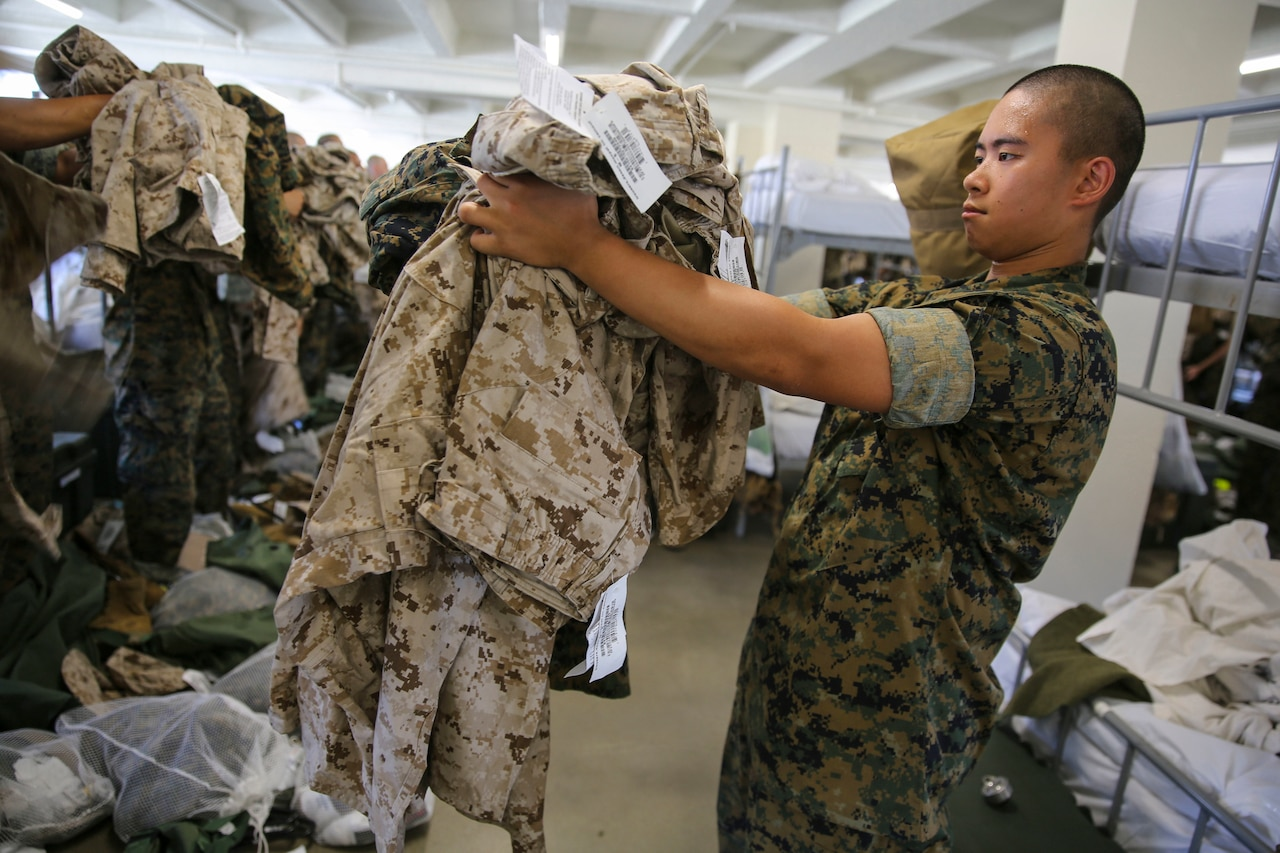 Men pick up military uniforms.