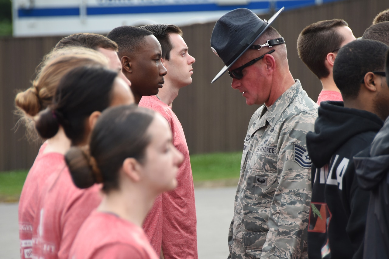An airman inspects new recruits.