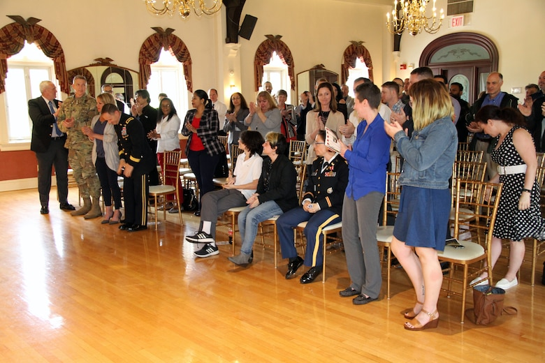Ceremony attendees give Lt. Col. Julie D'Annunzio a standing ovation following remarks at her retirement ceremony held May 10, at the Fort Hamilton Community Club's Washington Room in Brooklyn, New York.