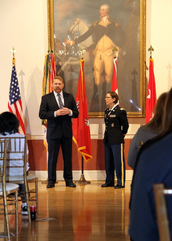 Col. (Retired) Bryan Green (left) made remarks about serving with Lt. Col. Julie D'Annunzio (right) during her retirement ceremony held May 10, at the Fort Hamilton Community Club's Washington Room in Brooklyn, New York.