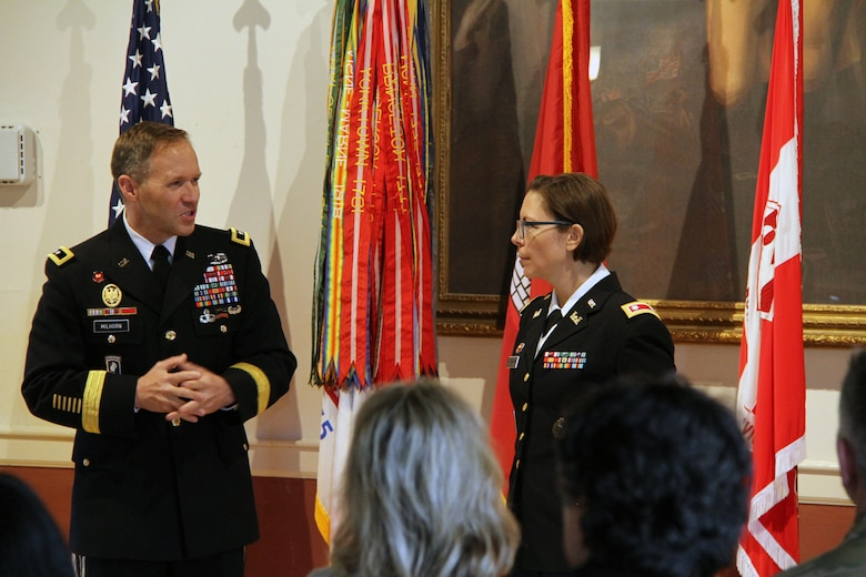 North Atlantic Division (NAD) Commanding General Maj. Gen. Jeffrey Milhorn (left) makes remarks during a retirement ceremony honoring Lt. Col. Julie D'Annunzio (right) at her retirement ceremony held May 10, at the Fort Hamilton Community Club's Washington Room in Brooklyn, New York.