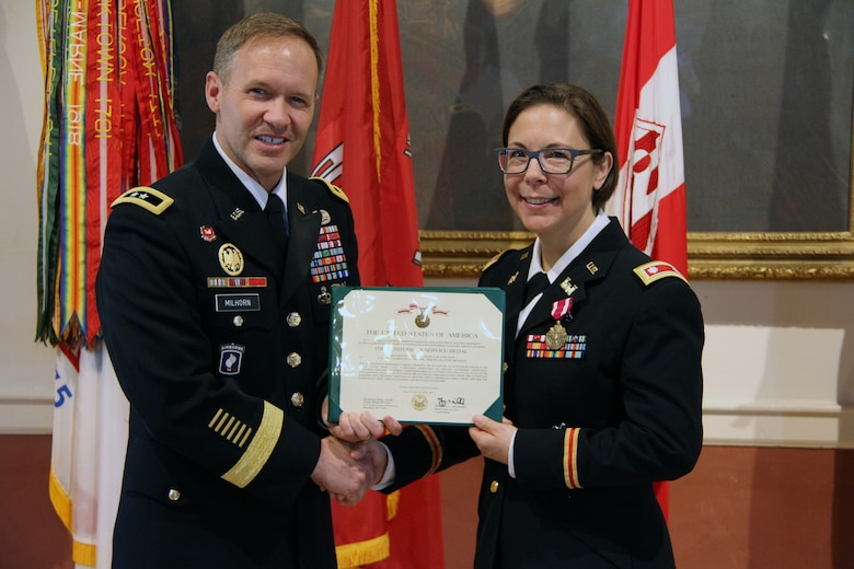 U.S. Army Corps of Engineers North Atlantic Division (NAD) Commander Maj. Gen. Jeffrey Milhorn presents Lt. Col. Julie D'Annunzio with a certificate to accompany the Meritorious Service Medal she received as an end-of-service award at her retirement ceremony held May 10, at the Fort Hamilton Community Club's Washington Room in Brooklyn, New York.