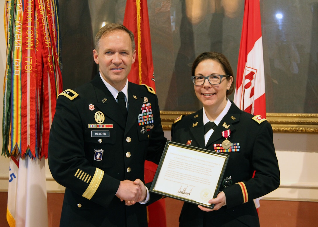 U.S. Corps of Engineers North Atlantic Division (NAD) Commander Maj. Gen. Jeffrey Milhorn (left) presents a certificate of appreciation from President Donald Trump to Lt. Col. Julie D'Annunzio (right) during her retirement ceremony held May 10, at the Fort Hamilton Community Club's Washington Room in Brooklyn, New York.
