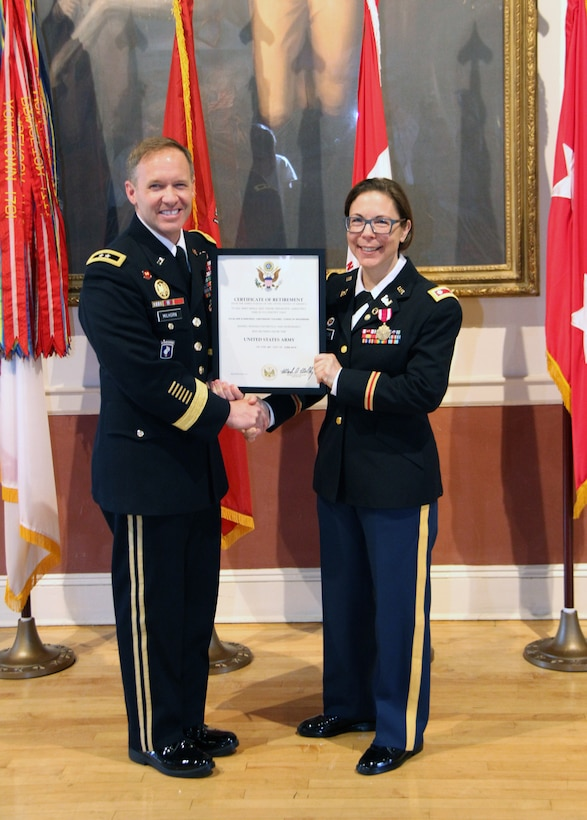 Lt. Col. Julie D'Annunzio (right) is presented with her certificate of retirement signed by U.S. Army Chief of Staff Gen. Mark Milley by Corps of Engineers North Atlantic Division (NAD) Commander Maj. Gen. Jeffrey Milhorn at a ceremony honoring her held May 10, at the Fort Hamilton Community Club's Washington Room in Brooklyn, New York.