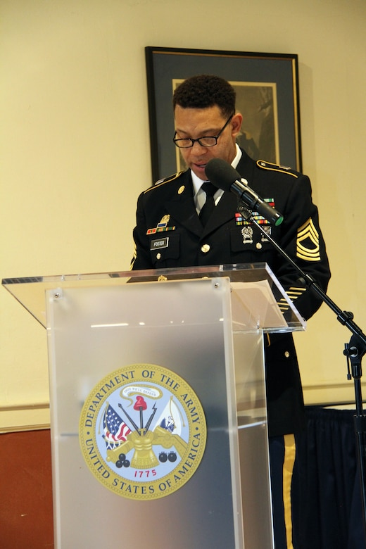 Master Sgt. David Foster narrates during a retirement ceremony honoring Lt. Col. Julie D'Annunzio held May 10, at the Fort Hamilton Community Club's Washington Room in Brooklyn, New York.