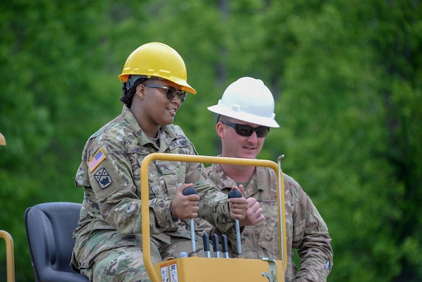 Sgt. Shantophia Cruz listens as Tech. Sgt. Doug Haveman explains operation of the Vermeer RT950.Airmen from the 241st Engineering Installation Squadron and Soldiers from the 230th Signal Company came together in Chatoosa, Georgia, May 9, 2019, to perform joint training. The 241st EIS Airmen provided training on heavy equipment needed to dig trenches for installation of fiber optics and other communications services.