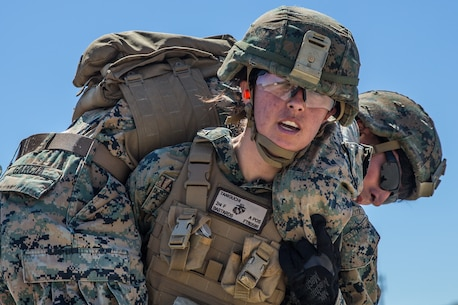 U.S. Marine Corps Lance Cpl. Autumn Taniguchi, a rifleman with Company F, 2nd Battalion, 4th Marine Regiment, 1st Marine Division, fireman carries Cpl. Antonio Garcia, a fire support Marine with 2nd Battalion, 11th Marine Regiment, during an Urban Leaders Course (ULC) at Marine Corps Base Camp Pendleton, California, April 24, 2019.