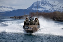 U.S. Marines with 1st Platoon, 1st Reconnaissance Battalion, 1st Marine Division, Marines with 1st Platoon, Force Reconnaissance Company, II Marine Expeditionary Force, and the Norwegian Coastal Ranger Commando (KJK) conduct CB90-class fast assault craft drills during exercise Platinum Ren at Fort Trondennes, Harstad, Norway, May 8, 2019.