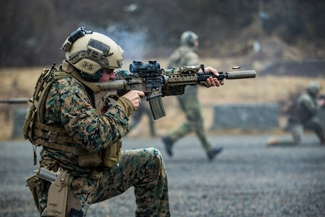 A U.S. Marine with 1st Reconnaissance Battalion, 1st Marine Division fires downrange amid an immediate action drill during exercise Platinum Ren at Fort Trondennes, Harstad, Norway, May 13, 2019.