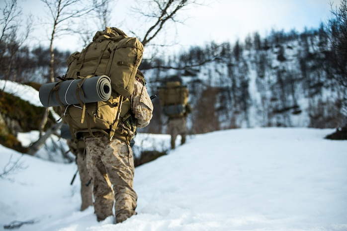 U.S. Marines with 1st Reconnaissance Battalion, 1st Marine Division, Marines with 2nd Reconnaissance Battalion, 2nd Marine Division, and the Norwegian Coastal Ranger Commando (KJK) patrol during exercise Platinum Ren in Norway, May 13, 2019.