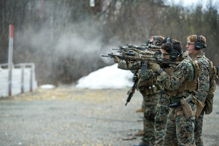 U.S. Marines with 1st Reconnaissance Battalion, 1st Marine Division, Marines with Force Reconnaissance Company, 2nd Reconnaissance Battalion, 2nd Marine Division, and the Norwegian Coastal Ranger Commando (KJK) execute transition drills during exercise Platinum Ren at Fort Trondennes, Harstad, Norway, May 15, 2019.