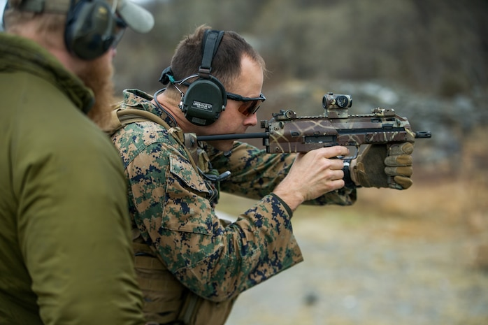 A U.S. Marine with 1st Reconnaissance Battalion, 1st Marine Division, fires an MP7 downrange amid a combat marksmanship drill during exercise Platinum Ren at Fort Trondennes, Harstad, Norway, May 15, 2019.