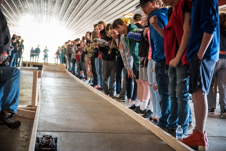 Students from nine local schools watch the remote-controlled car races during the Air Force Research Laboratory's 7th annual Full Throttle STEM at Eldora Speedway May 14. (U.S. Air Force photo/Richard Eldridge)