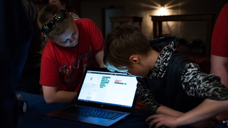 Two fourth grade students from Tri-County North practice their programing skills using software applications during the Air Force Research Laboratory's 7th annual Full Throttle STEM at Eldora Speedway May 14. (U.S. Air Force photo/Richard Eldridge)