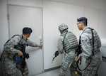 374th Security Forces Squadron Airmen clear a building during an active shooter scenario during exercise Beverly Morning 19-01, May 13, 2019, at Yokota Air Base, Japan. Yokota Airmen participated in simulated war-time scenarios including active shooter scenario, rapid runway repair and a mass-casualty incident.