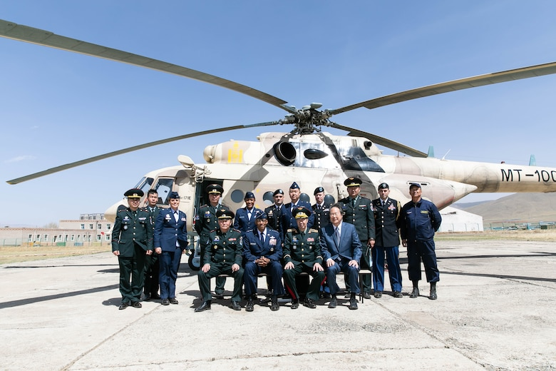 Gen. CQ Brown, Jr., Pacific Air Forces commander, and his staff, visit with members of the Mongolian Air Force Command during a tour of Unit 303 at the Chinggis Khaan International Airport May 14. In his first visit to the country, Brown met with senior leaders from Mongolia and the United States to seek opportunities to enhance cooperation and partnership with the Mongolian Air Force Command. (photo courtesy US Embassy)