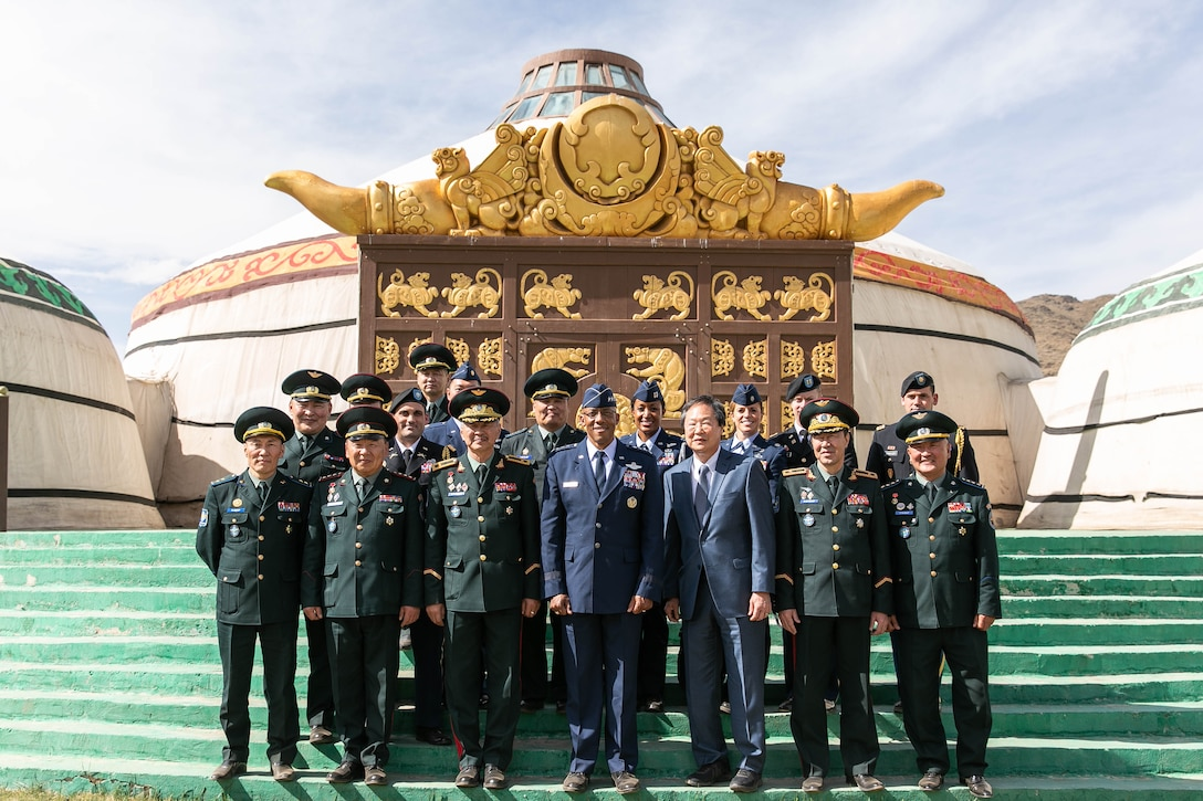 Gen. CQ Brown, Jr., Pacific Air Forces commander, Brig. Gen. Enkhbayar Ochir, commander of Mongolian Air Force Command (MAFC), and their staffs pose for a group photo at the Chingisiin Huree camp south of Mongolia's capital, Ulaanbaatar, May 14. In addition to evaluating the recent success of the Airman-to-Airman Talks in Hawaii in March, discussions during the visit included opportunities to enhance training, exercises and subject matter expert exchanges. (photo courtesy US Embassy)