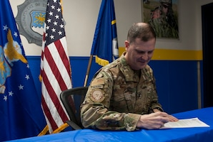 Col. Aaron Guill, 341st Security Forces Group commander, signs a proclamation to kick-off National Police Week events May 13, 2019, at Malmstrom Air Force Base, Mont.