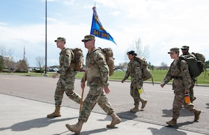 Col. Aaron Guill, 341st Security Forces Group commander, and Chief Master Sgt. Wesley McMackin 341st SFG superintendent, lead members of the 341st SFG on a 5K memorial road march May 14, 2019, at Malmstrom Air Force Base, Mont