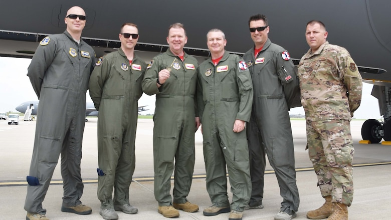 Members of a Team McConnell aircrew pose with Lt. Gen. Richard Scobee, Chief of the Air Force Reserve and Air Force Reserve Command commander, in front of a newly delivered KC-46A Pegasus May 17, 2019, at McConnell Air Force Base, Kan. Scobee was presented with a ceremonial key as part of the event. This is the sixth KC-46 to be delivered to McConnell.