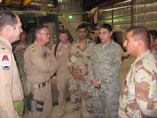 Capt. Aljammaly stands with teammates in Iraq. Aljammaly direct commissioned into the Air Force in 2015.