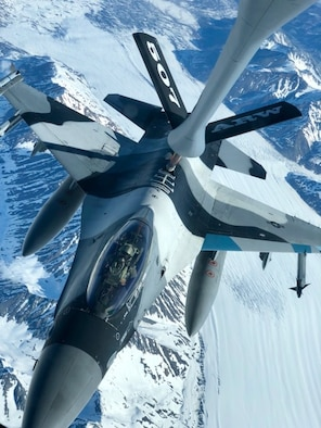 A 465th Air Refueling Squadron aircrew and U.S. Air Force Reserve KC-135 Stratotanker out of Tinker Air Force Base, Oklahoma, refuel an F-16 Fighting Falcon from the 18th Aggressor Squadron at Eielson Air Force Base, Alaska, May 14, 2019, during exercise Northern Edge. Northern Edge provides effective, capabilities-centered joint forces, ready for deployment worldwide and enables real-world proficiency in detection, identification and tracking of units at sea, in the air and on land and respond to multiple crisis in the Indo-Pacific region. (U.S. Air Force photo by Tech Sgt. Bobby Jackson)