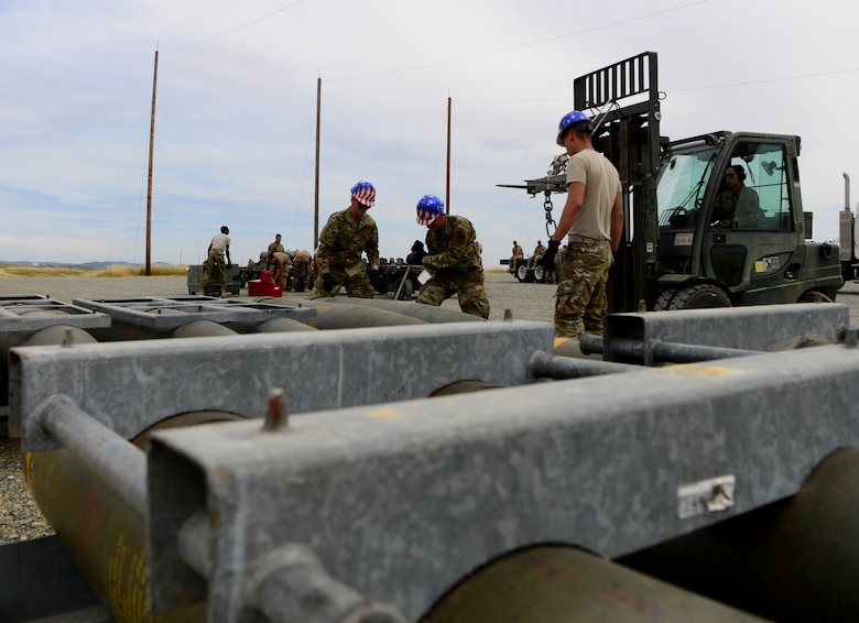 A photo of Airmen preparing to move munitions.