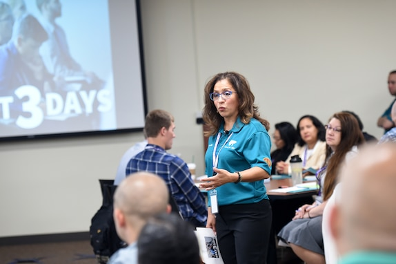 Carmella Navarro, Suicide Prevention Program Manager, 85th U.S. Army Reserve Support Command, gives remarks during the 85th USARC's 'Stand For Life' suicide prevention training, May 6-10, 2019, at the 85th USARSC headquarters.