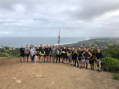 U.S. Marines assigned to 12th Marine Corps District, Western Recruiting Region, pose for a photo at Mount Soledad after a physical training event in San Diego, Calif., May 17, 2019.