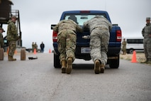 U.S. Air Force Airmen pushing truck