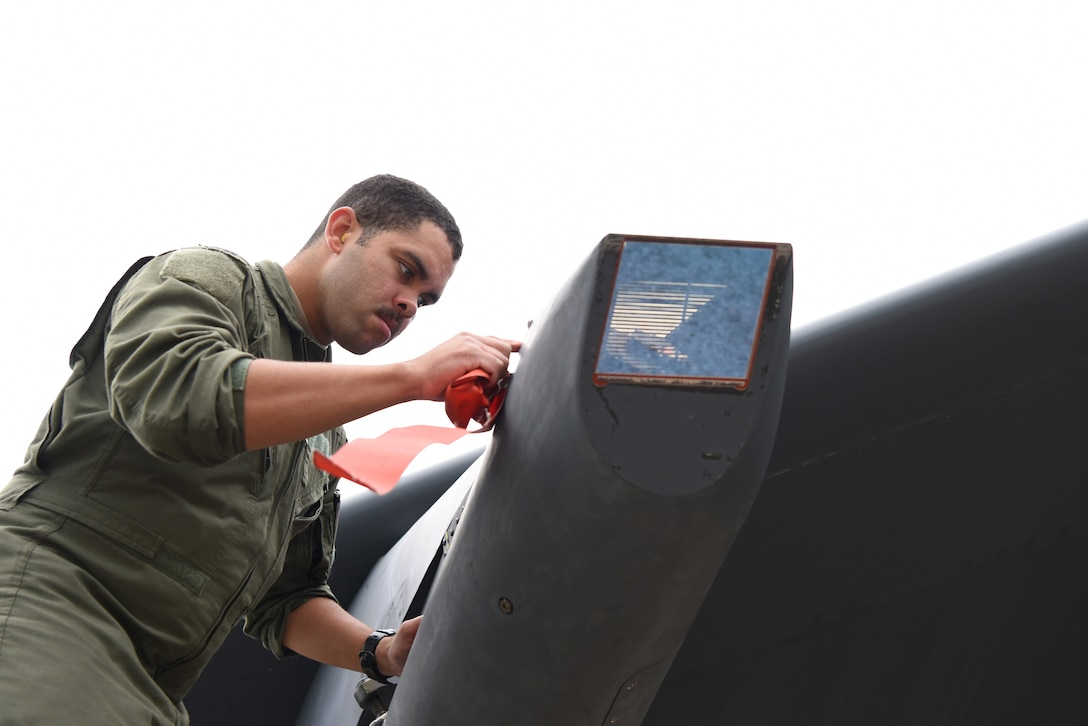 U.S. Air Force Capt. Nathan Fisher, 23rd Expeditionary Bomb Squadron weapons systems operator, conducts a preflight inspection for a B-52 Stratofortress during Exercise Diamond Storm at Royal Australian Air Force Base Darwin, Northern Territory, Australia, May 9, 2019.