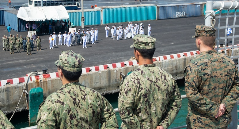 Sattahip, Thailand (May 18, 2019) – Members of the Royal Thai Navy welcome fast expeditionary transport ship USNS Fall River (T-EPF 4) to Thailand as Pacific Partnership participants man the rails. Pacific Partnership, now in its 14th iteration, is the largest annual multinational humanitarian assistance and disaster relief preparedness mission conducted in the Indo-Pacific. Each year the mission team works collectively with host and partner nations to enhance regional interoperability and disaster response capabilities, increase security and stability in the region, and foster new and enduring friendships in the Indo-Pacific.