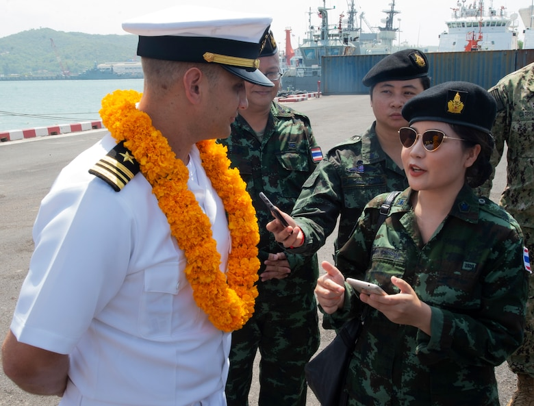 Sattahip, Thailand (May 18, 2019) – Royal Thai Navy 2nd Lt. Munlika Suwannasawad, Pacific Partnership 2019 (PP19) public relations officer, interviews U.S. Navy Lt. Cmdr. Nick Lyons, PP19 operations officer, following the arrival of the fast expeditionary transport ship USNS Fall River (T-EPF 4) in Thailand. Pacific Partnership, now in its 14th iteration, is the largest annual multinational humanitarian assistance and disaster relief preparedness mission conducted in the Indo-Pacific. Each year the mission team works collectively with host and partner nations to enhance regional interoperability and disaster response capabilities, increase security and stability in the region, and foster new and enduring friendships in the Indo-Pacific.