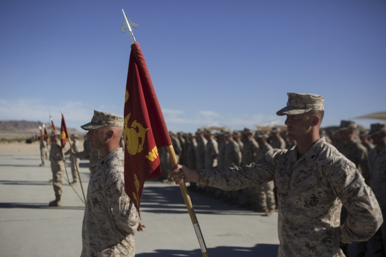 Marines stand in formation.